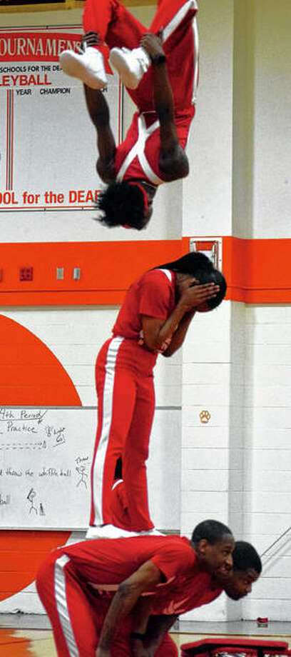 A member of the Jesse White Tumblers team flips over his teammates Friday at the Illinois School for the Deaf. Photo: Samantha McDaniel-Ogletree | Journal-Courier