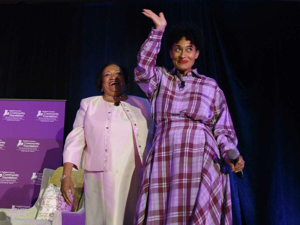 """Actress, producer and activist Tracee Ellis Ross waves to the crowd after being introduced for the keynote conversation """"Brave, Bold, You"""" by moderator Juanita James, President and CEO of Fairfield County's Community Foundation, during Fairfield County's Community Foundation Fund for Women & Girls annual luncheon at the Hyatt Regency in Old Greenwich, Conn. Thursday, April 4, 2019. Ross is known for her lead role on ABC's """"black-ish"""" and has won a Golden Globe along with several NAACP Image Awards for her work."""