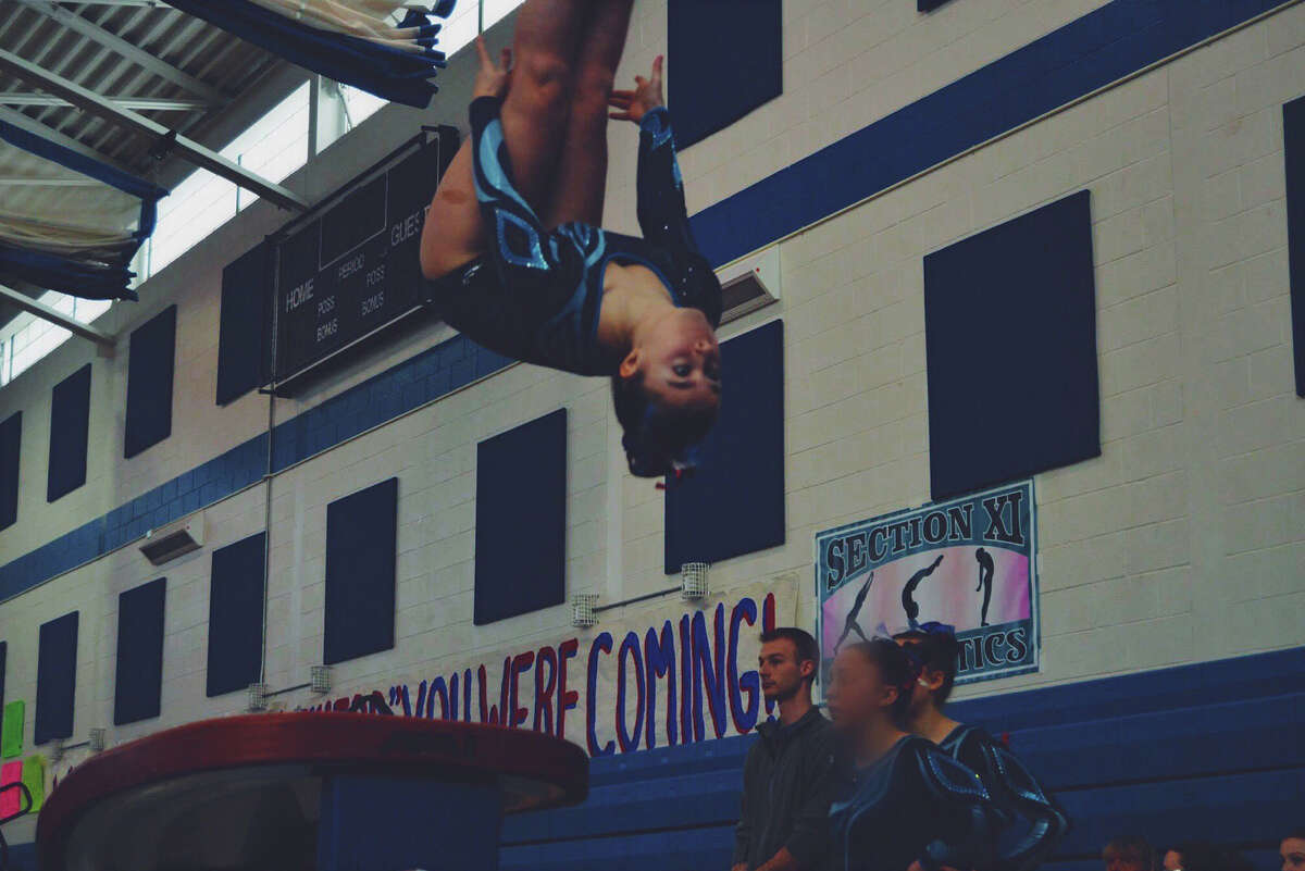 Senior Laura Eberlein, a member of the Saratoga Springs gymnastics team, competes in this undated photo. (Provided)