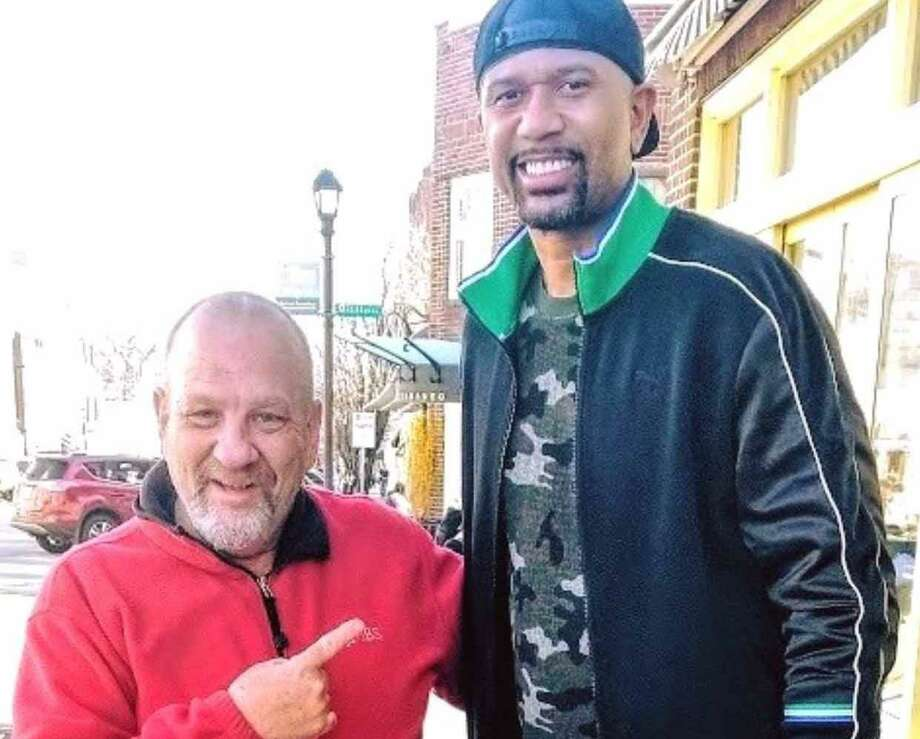 Greenwich resident Robert Harris with former NBA star Jalen Rose on Greenwich Avenue last week. Photo: Contributed