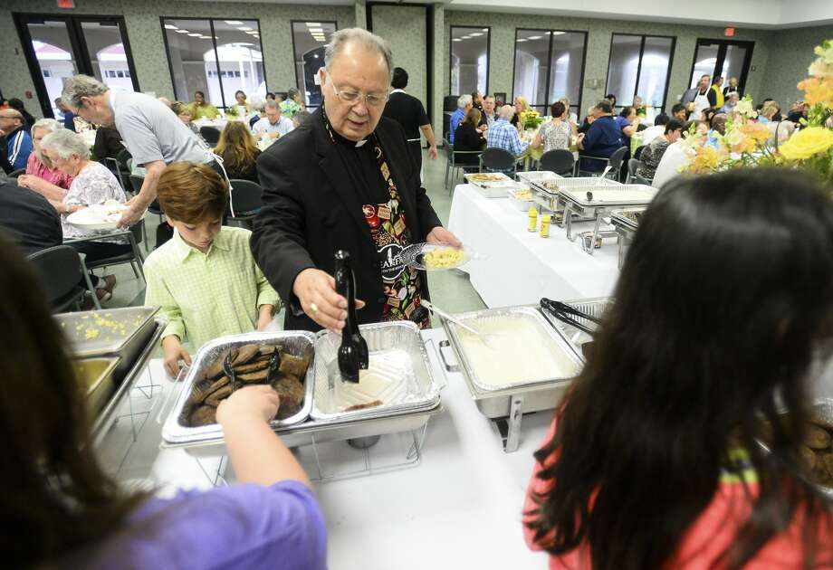Bishop Curtis Guillory gets food during Breakfast with the Bishop at St. Anne Parish Hall Saturday morning. Photo taken on Friday. Ryan Welch/The Enterprise Photo: Ryan Welch/The Enterprise
