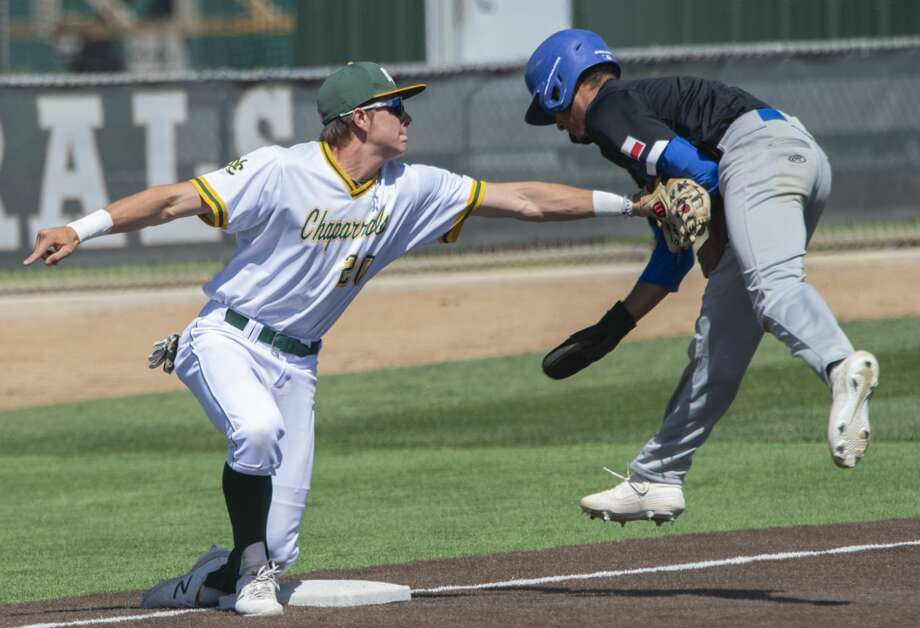 Western Texas' Abel Pena tries to avoid the tag as he steals third 04/06/19 but Midland College's Ethan Mann makes the play for an out in the first game of a double header at Christensen Stadium. Tim Fischer/Reporter-Telegram Photo: Tim Fischer/Midland Reporter-Telegram