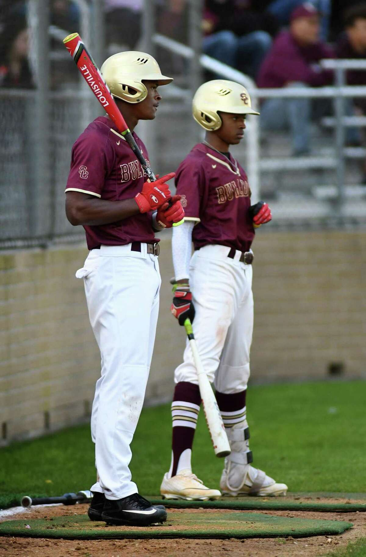 Andre Duplantier II, from left, a Summer Creek senior and varsity shortstop and pitcher for the Bulldogs, stands in the on deck circle with his brother Jayden, a Summer Creek freshman and varsity second baseman, before their at bats in the bottom of the 1st inning of their District 22-6A matchup with the Dobie Longhorns at SCHS on March 14, 2019.