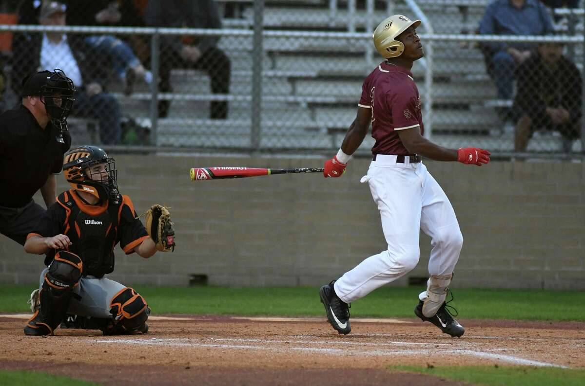 Summer Creek senior shortstop and pitcher Andre Duplantier II drives a ball deep against Dobie in the bottom of the 1st inning of their District 22-6A matchup at SCHS on March 14, 2019.