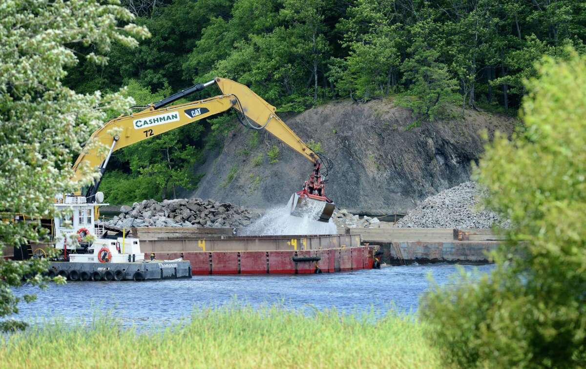 Work on General Electric?s ongoing PCB remediation in the upper Hudson River continues near Lock 2 just south of Mechanicville Thursday afternoon, Aug. 20, 2015, in Halfmoon, N.Y. GE said it has cost more than $1 billion to field a flotilla of dredges and barges as well as build the treatment plant. Between 1947 and 1977, GE dumped 1.3 million pounds of PCBs into the Hudson from capacitor plants in Hudson Falls and Fort Edward. (Will Waldron/Times Union)