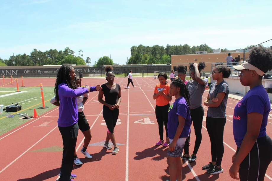 Humble girls head coach Skyla Williams talking with the Lady Wildcats at practice at Turner Stadium. Photo: Marcus Gutierrez/staff Photo