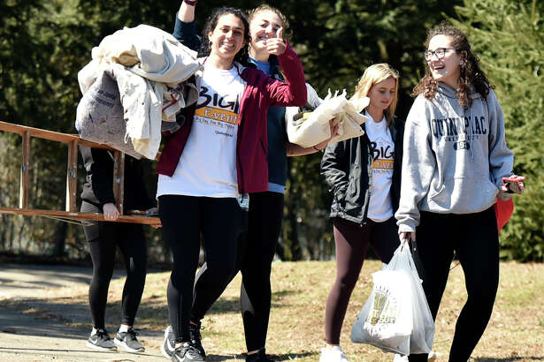 "New Haven, Connecticut - Saturday, April 6, 2019: The Quinnipiac University students and staff that did spring cleanup work outdoors at Edgerton Park in New Haven, are among the approximately 1500 Quinnipiac University Big Event honors program students participated in the 10th annual Big Event cleanup at 75 locations in greater New Haven area. ""Started 37 years ago at Texas A & M University, the Big Event has grown to be the largest, one-day, student-run service project in the nation,"" according to a Quinnipiac University website. The goal of the Big Event is to give QU students the opportunity to provide community service to residents in the surrounding Greater New Haven community. ""Quinnipiac's Big Event was founded in 2010 by the Vice President of Public Relations for the QU Student Government Association, Jen Walts. This past year (2018) over 1,600 students completed over 4,500 hours of community service."""