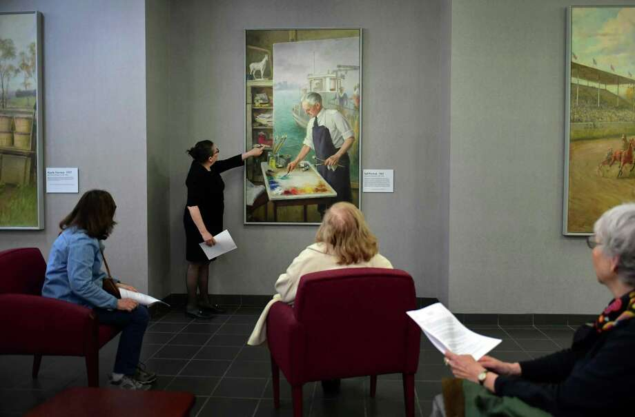 WPA docent Melissa Slattery gives a talk about several WPA works of art including Alexander Rummler's Self-Portrait during Slow Art Day on Saturday, April 6, 2019, at Norwalk City Hall in Norwalk, Conn. One day each year people all over the world visit local museums and galleries on Slow Art Day to look at art more slowly. Participants look at five works of art for 10 minutes each and then meet together over lunch to talk about their experience. This year over 170 venues participated internationally. Photo: Erik Trautmann / Hearst Connecticut Media / Norwalk Hour