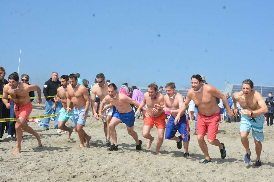 The Fairfield Penguin Plunge was held at Jennings Beach on April 6, 2019. Plungers braved the cold Long Island Sound to raise money for the Special Olympics Connecticut. Were you SEEN? Photo: Vic Eng / Hearst Connecticut Media Group