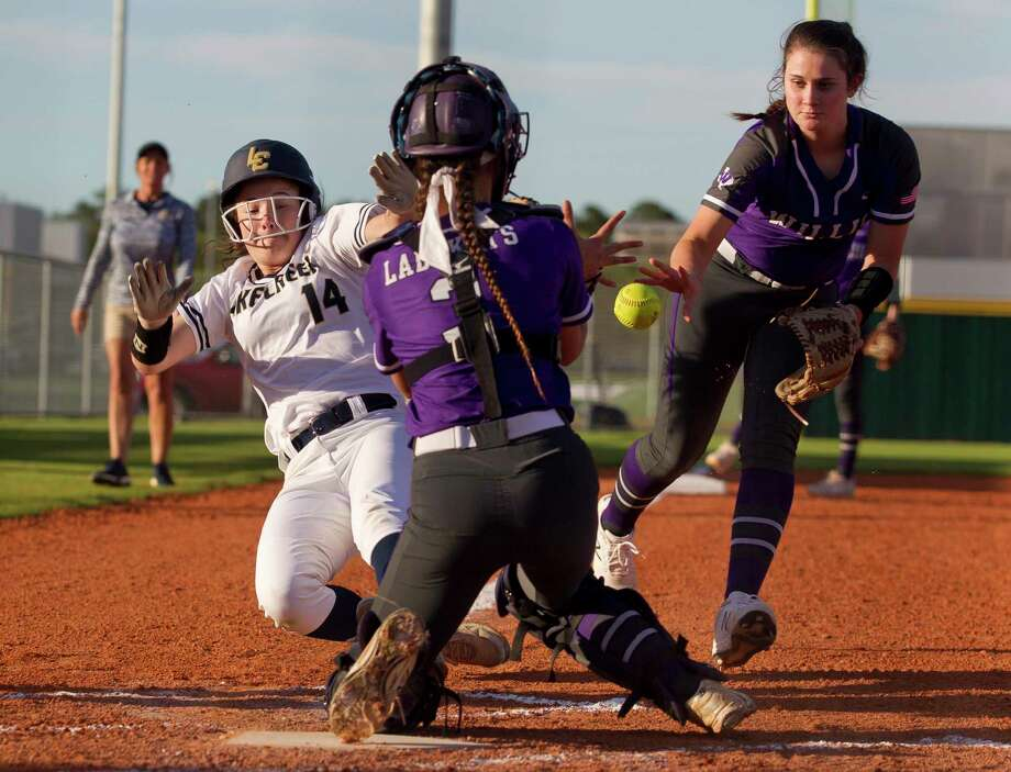 Lauren Wilking #14 of Lake Creek beats the throw from Willis third baseman Madison Matranga (18) to catcher Hailey Eten (3) to score during the first inning of a District 20-5A high school softball game at Lake Creek High School, Thursday, March 14, 2019, in Montgomery. Photo: Jason Fochtman, Houston Chronicle / Staff Photographer / © 2019 Houston Chronicle