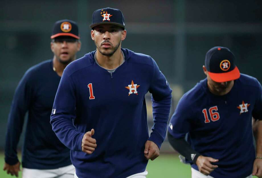 "Houston Astros shortstop Carlos Correa wears the Travis Scott ""Wish You Were Here"" New Era limited edition baseball cap, which is associated with his Astroworld project, during batting practice before the start of an MLB at Minute Maid Park, Saturday, April 6, 2019, in Houston. Photo: Karen Warren, Staff Photographer / © 2019 Houston Chronicle"