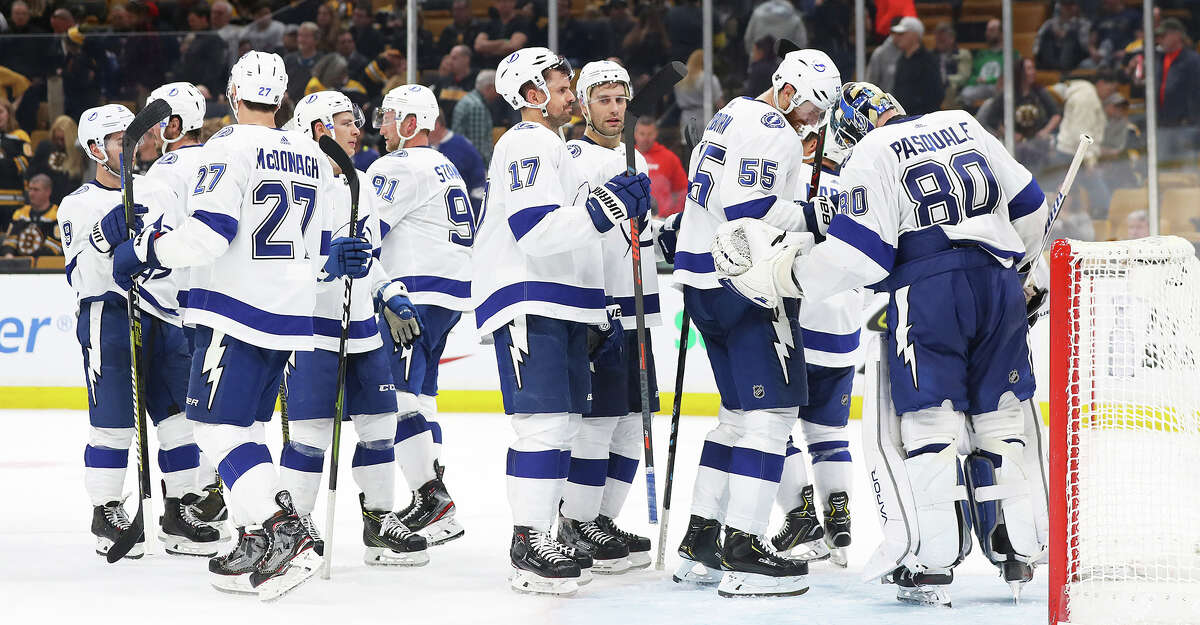 The Tampa Bay Lightning celebrate with goaltender Edward Pasquale (80) after a 6-3 win against the Boston Bruins at TD Garden in Boston on Saturday, April 6, 2019. **FOR USE WITH THIS STORY ONLY** (Maddie Meyer/Getty Images/TNS)