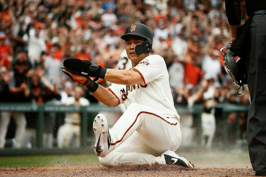 San Francisco Giants second baseman Connor Joe (18) slides at home and scores against the Tampa Bay Rays at Oracle Park on Saturday, April 6, 2019, in San Francisco, Calif. Photo: Santiago Mejia / The Chronicle
