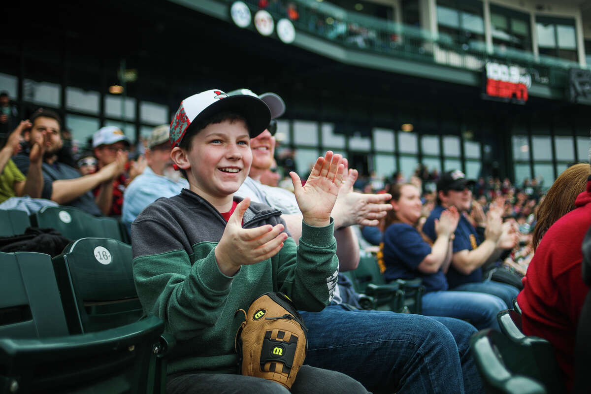 Jack Roberts of Midland, 12, claps his hands after the Great Lakes Loons score a run during their first home game of the season against Lake County on Saturday, April 6, 2019 at Dow Diamond. (Katy Kildee/kkildee@mdn.net)