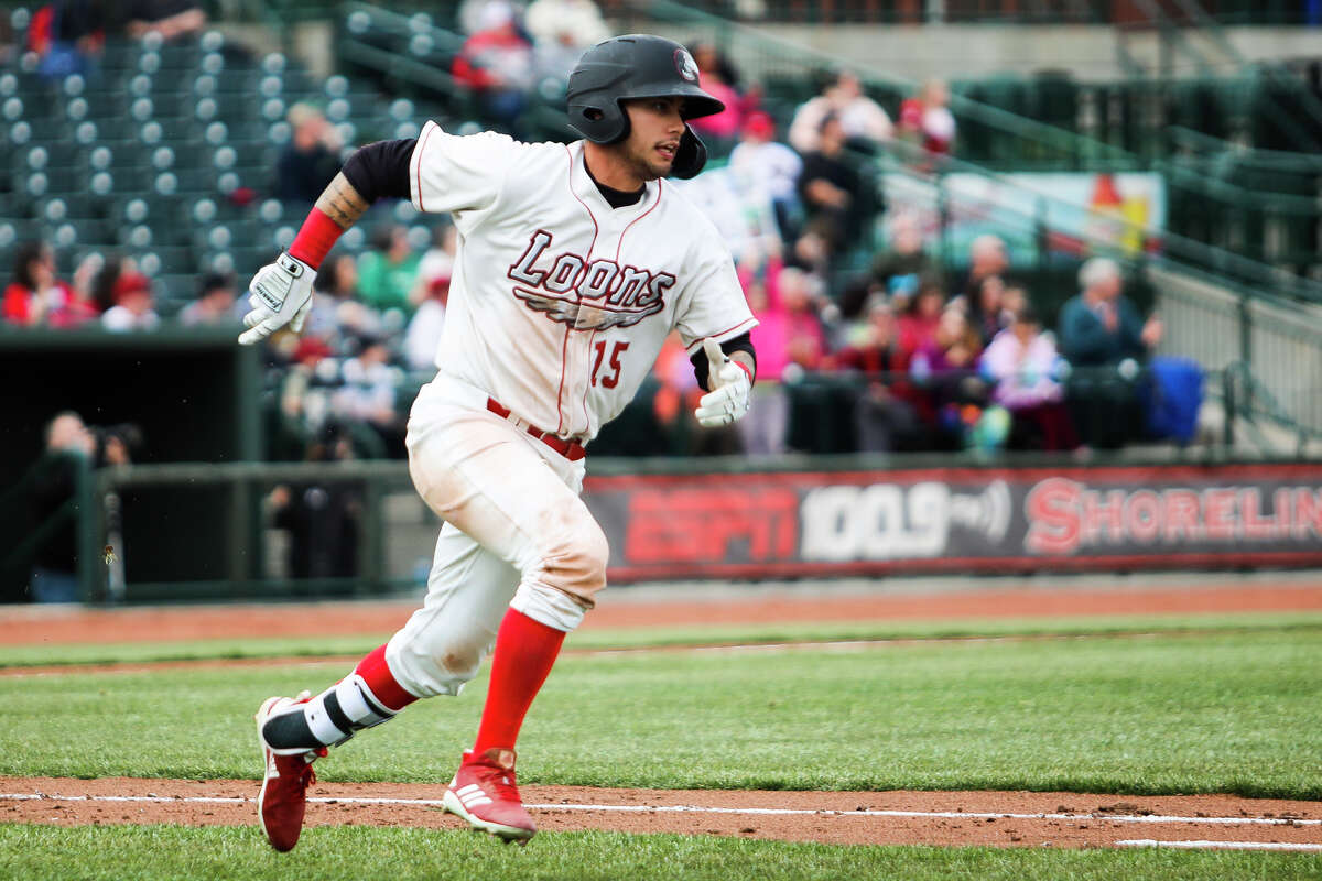 Great Lakes Loons shortstop Jacob Amaya sprints toward first base during the Loons' game against Lake County on Saturday, April 6, 2019 at Dow Diamond. (Katy Kildee/kkildee@mdn.net)