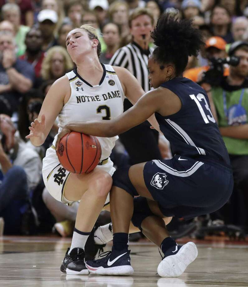Notre Dame's Marina Mabrey (3) fouls UConn's Christyn Williams (13) during the first half of Friday's Final Four semifinal in Tampa, Fla. Photo: Chris O'Meara / Associated Press / Copyright 2019 The Associated Press. All rights reserved.