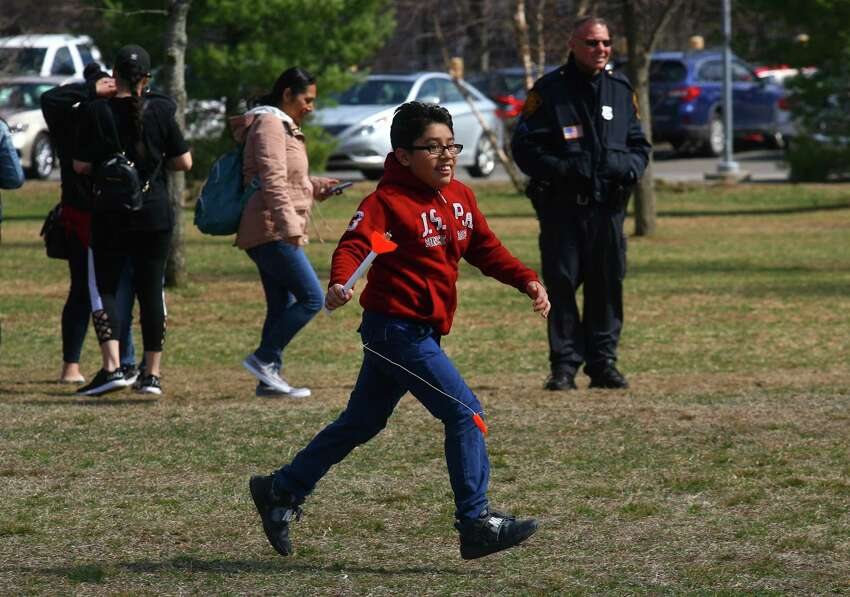 Giancarlo Perez Antonio, 11, runs back to the launch site with the rocket he shot into the air during the Discovery Museum's annual Science Day in Bridgeport, Conn., on Saturday, April 6, 2019. As many as 1400 children got to take part in a variety of activities related to space research and exploration. Some of the highlights included a Live Science Demo, Astronaut Training, drone flights with Connecticut Wild Flyers and even a piece of moon rock on display. Science Day is made possible by a grant from the NASA Connecticut Space Grant Consortium.