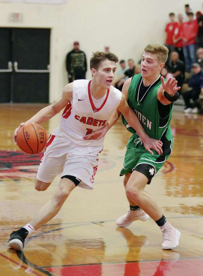 best sneakers 81574 aba44 Albany Academy s August Mahoney dribbles the ball down the court during a game  against Bishop Ludden