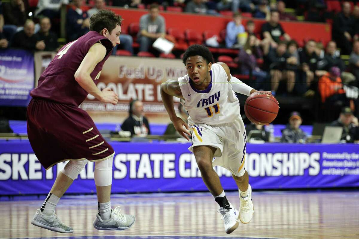 Troy's Nazaire Merritt (11) moves up the floor with Mendon?s, Connor Krapf, 4 , during Troy?s Class A semi-final loss at the boy?s basketball state championships in Binghamton. (Erin Reid Coker/Special to the Times Union)