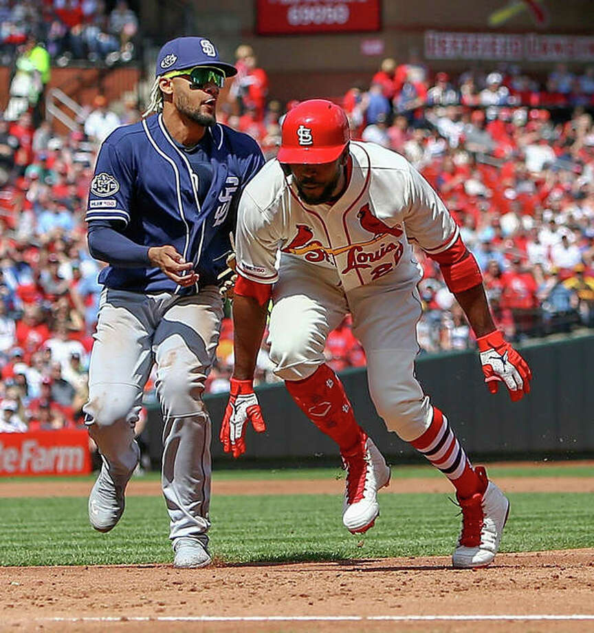 The Cardinals' Dexter Fowler (right) is tagged out by Padres shortstop Fernando Tatis Jr. after being caught in a run down during the second inning Saturday at Busch Stadium. Photo: Scott Kane / Associated Press