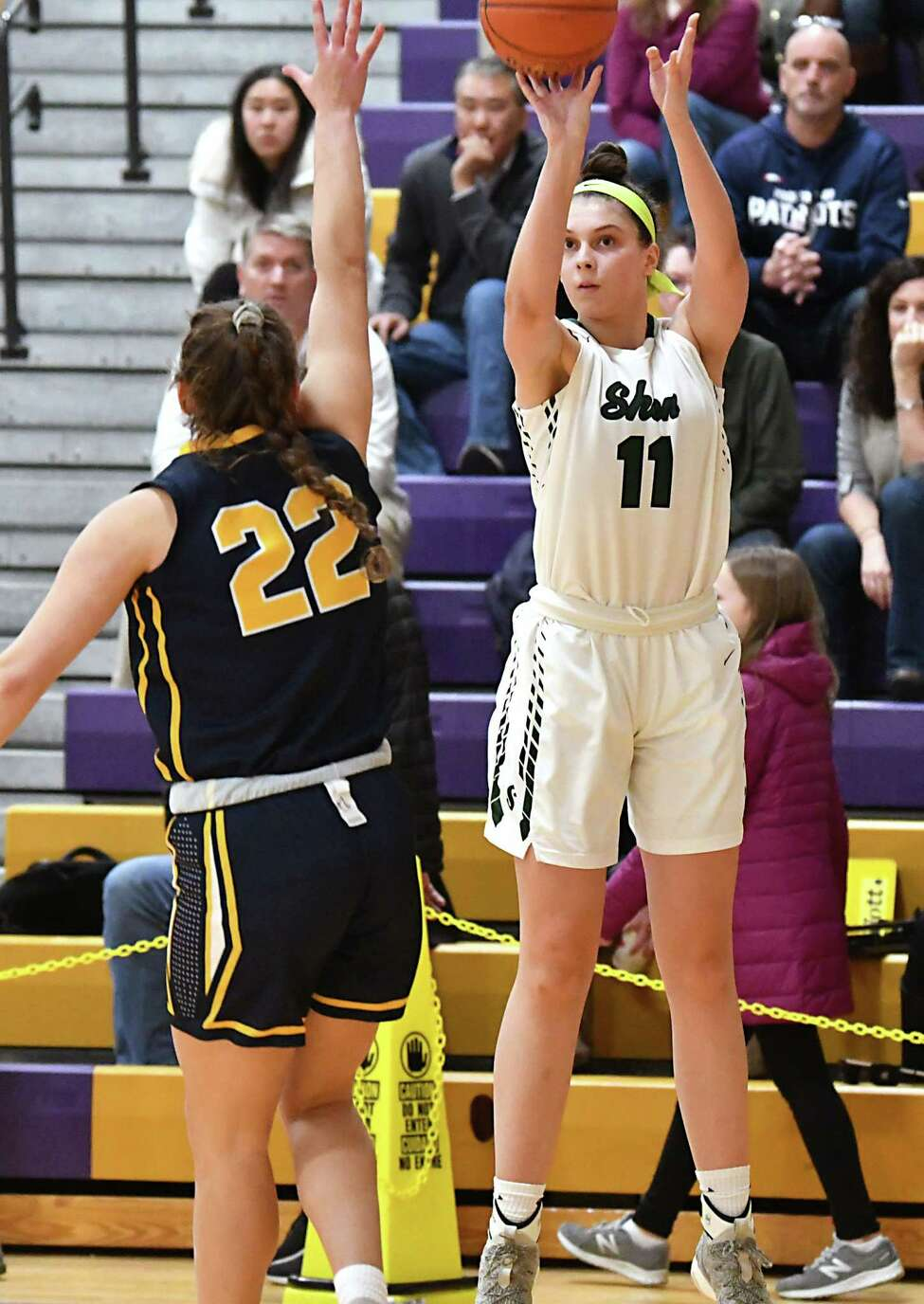 Shenendehowa's Cat Almeida, #11, is guarded by West Genesee's Julia Logana as she goes up for a three-pointer during a basketball game on Friday, Dec. 28, 2018 in Amsterdam, N.Y. (Lori Van Buren/Times Union)