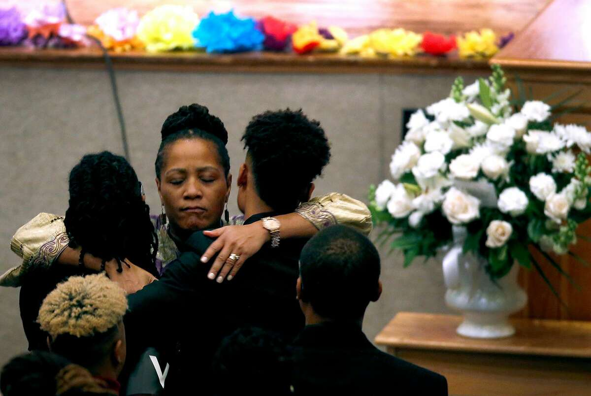 Oakland city council member Lynette Gibson McElhaney consoles family friends at a memorial service and celebration of life for her son Victor McElhaney in Oakland, Calif. on Saturday, March 23, 2019. Victor McElhaney, 21, a music major at USC, was killed during a robbery in Los Angeles two weeks ago.