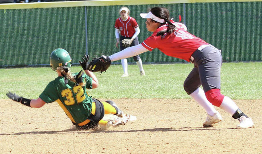 Alton shortstop Tami Wong lunges to apply the tag on Southwestern's Bri Roloff (32), who is called out stealing the in the fifth inning Saturday morning at Alton High in Godfrey. Photo: Greg Shashack / The Telegraph