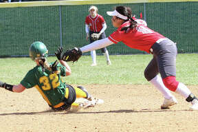 Alton shortstop Tami Wong lunges to apply the tag on Southwestern's Bri Roloff (32), who is called out stealing the in the fifth inning Saturday morning at Alton High in Godfrey.
