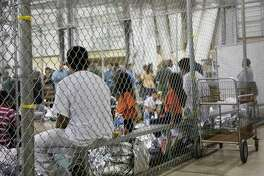 FILE - In this June 17, 2018 file photo provided by U.S. Customs and Border Protection, people who've been taken into custody related to cases of illegal entry into the United States, sit in one of the cages at a facility in McAllen, Texas. The Trump administration wants up to two years to find potentially thousands of children who were separated from their parents at the border before a judge halted the practice last year. The Justice Department said in a court filing late Friday, April 5, 2019 in San Diego that it will take at least a year to review the cases of 47,000 unaccompanied children taken in custody between July 1, 2017 and June 25, 2018. (U.S. Customs and Border Protection's Rio Grande Valley Sector via AP)