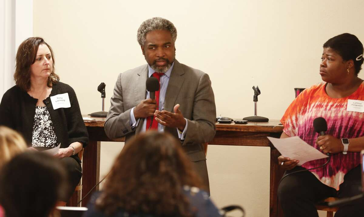 Texas Education Agency Deputy Commissioner of Governance AJ Crabill talks during a town hall with residents at the First Evangelical Lutheran Church Saturday, April 6, 2019, in Houston. Tracy Lisewsky (left) and LaTrice Ferguson (right) severed as moderators.