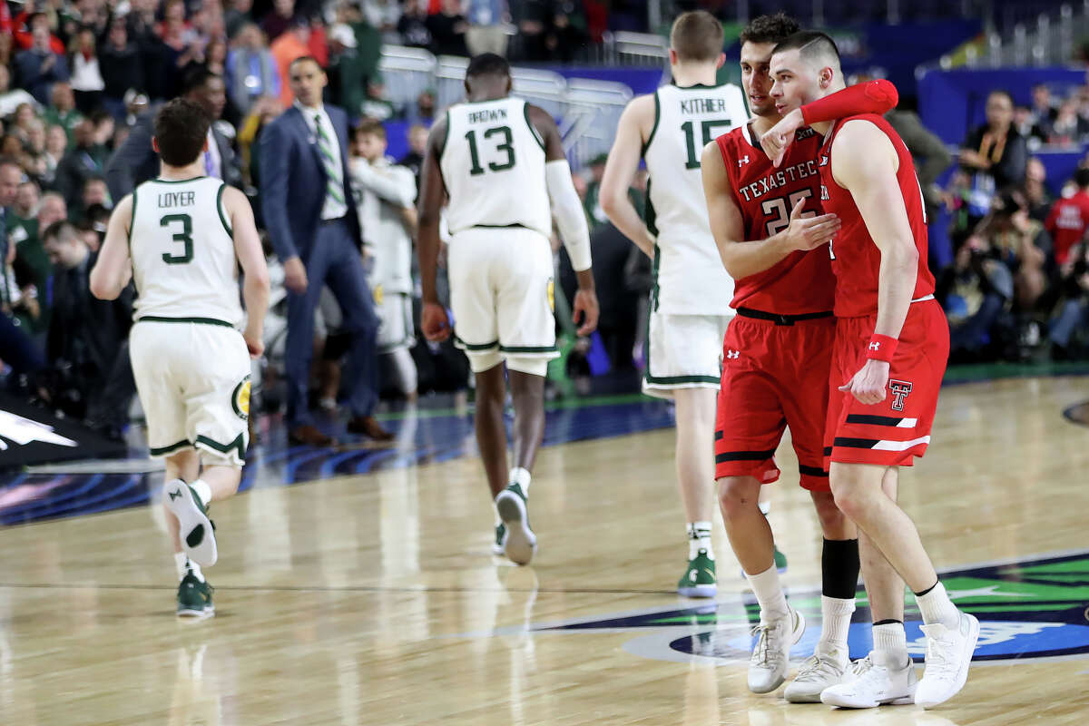 Texas Tech's Davide Moretti (25) and Matt Mooney (13) embrace after a win against Michigan State during the NCAA Division I Men's Basketball semifinal April 6, 2019, in Minneapolis, Minnesota. James Durbin / Reporter-Telegram