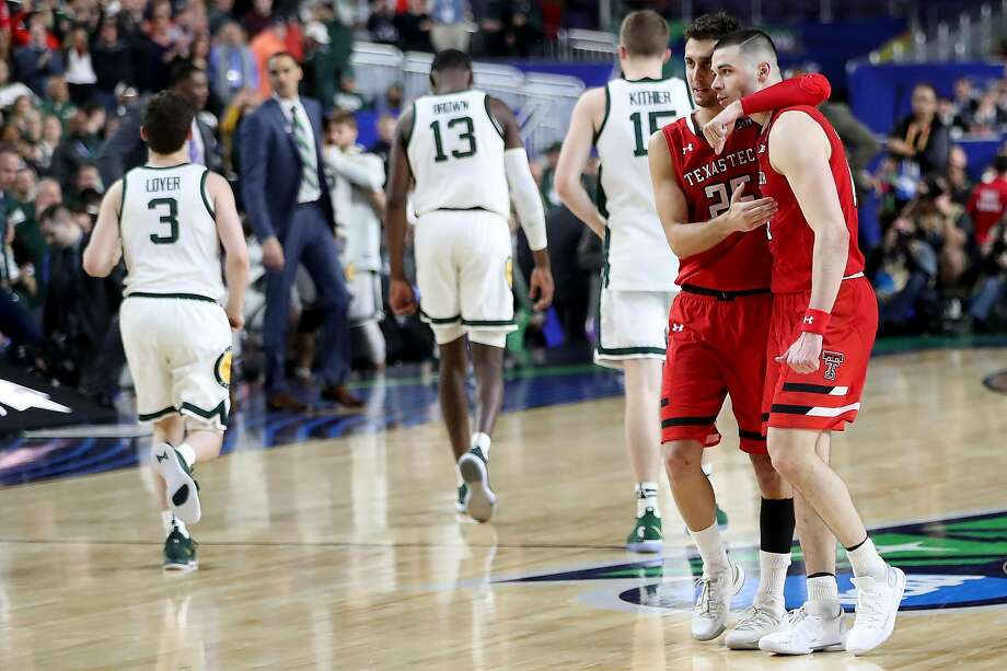 Texas Tech's Davide Moretti (25) and Matt Mooney (13), who scored a game-high 22 points to tie his season high , embrace after the win against Michigan State in the team's first Final Four. Photo: James Durbin / Midland Reporter-Telegram