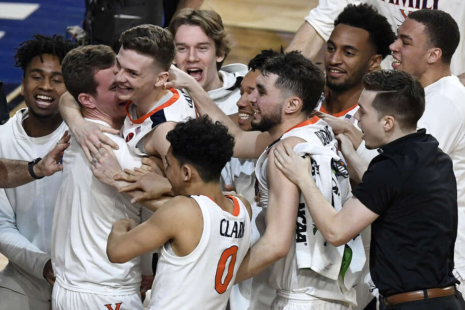 Kyle Guy #5 of the Virginia Cavaliers celebrates with teammates after defeating the Auburn Tigers 63-62 during the 2019 NCAA Final Four semifinal at U.S. Bank Stadium on April 6, 2019 in Minneapolis, Minnesota. (Photo by Hannah Foslien/Getty Images) Photo: Getty Images