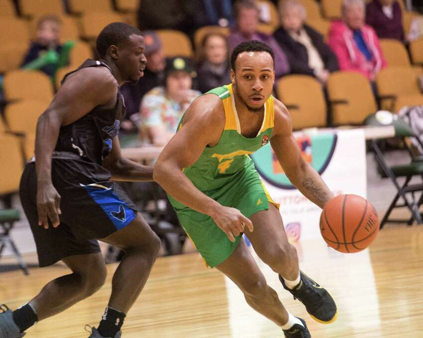 Albany Patroons guard Shadell Millinghaus drives around a Jamestown Jackals defender at the Washington Avenue Armory on Saturday, April 6, 2019. (Jim Franco/Special to the Times Union)