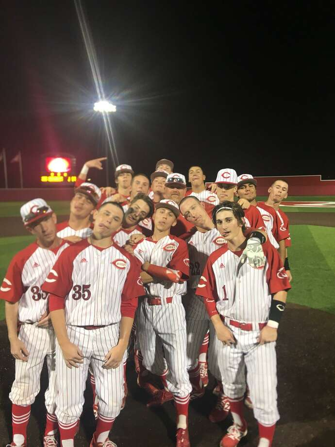 The Crosby Cougar baseball team poses for a picture with coach Chris Wiggins after Wiggins got his 200th career win at Crosby with a 2-1 victory over Santa Fe on March 29 Photo: Crosby Baseball Twitter