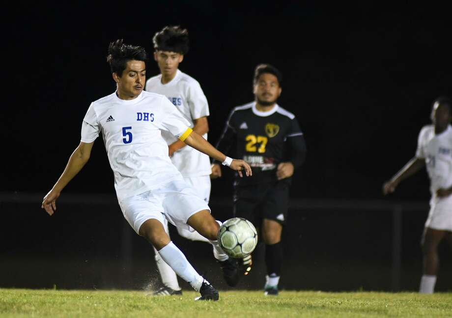Dekaney junior center back Victor David Hernandez (5) works the ball upfield against Eisenhower during the first period of their district matchup at Plummer Stadium on March 22, 2019. Photo: Jerry Baker, Houston Chronicle / Contributor / Houston Chronicle
