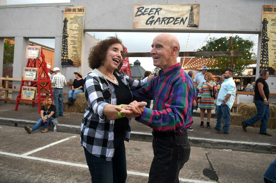 Andrea Delgado, left, of Kingwood, and dance partner Ernest Thieleman, of Huffman, take advantage of the music from the Louis Adams Diaz Band, of Houston, during Street Dance activities held to kickoff the 39th Annual Good Oil Days in downtown Humble on April 5, 2019. Photo: Jerry Baker, Houston Chronicle / Contributor / Houston Chronicle