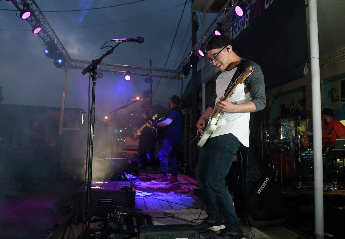 Guitarist Paul Garza, of Houston, performs with the Louis Adams Diaz Band during the Street Dance activities held to kickoff the 39th Annual Good Oil Days in downtown Humble on April 5, 2019.