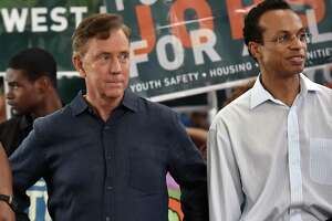 Democratic gubernatorial candidate Ned Lamont and Shawn Wooden, a Democrat running for state treasurer at the Goffe Street Park Wednesday, August 8, 2018, where organizers from New Haven Rising, Unite Here! and the anti-violence group, Ice the Beef held a march focused on youth safety, good jobs, affordable housing.
