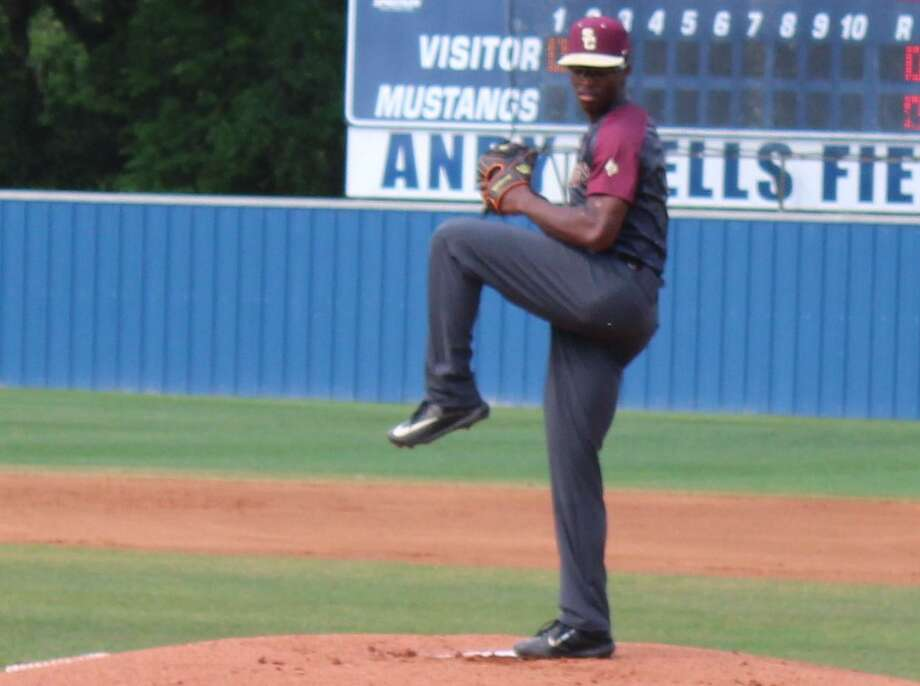 Andre Duplantier II pitching during Summer Creek District 22-6A game between Kingwood at Andy Wells Field. Photo: Marcus Gutierrez/staff Photo