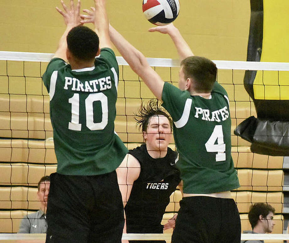 Edwardsville's Josh Whittenburg slams a kill past two Pattonville blockers during the third game of a semifinal match at the Vianney Invitational. Photo: Matt Kamp/The Intelligencer