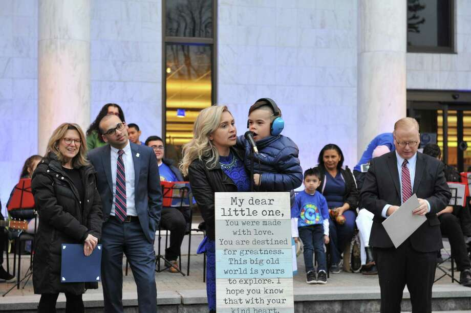 The city celebrated World Autism Awareness Day last Tuesday by lighting the library in blue. Emanuela Palmares speaks with her son, Caio, at the ceremony. Mayor Mark Boughton is right. State Sen. Julie Kushner, D-Danbury, and State Rep. Raghib Allie-Brennan, D-Bethel, are left. Photo: / Contributed Photo
