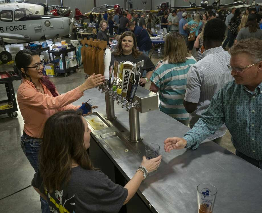 Beer lovers enjoy a night of tasting 04/06/19 at the High Sky Wing of the CAF Hops & Props fundraiser in the High Sky Wing hanger. Tim Fischer/Reporter-Telegram Photo: Tim Fischer/Midland Reporter-Telegram