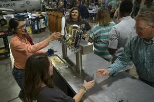Beer lovers enjoy a night of tasting 04/06/19 at the High Sky Wing of the CAF Hops & Props fundraiser in the High Sky Wing hanger. Tim Fischer/Reporter-Telegram