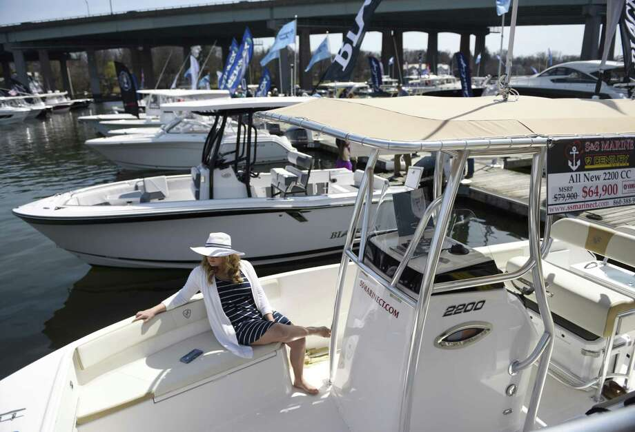 Old Saybrook resident Melissa Sundholm sits in a Century 2200 CC boat at the 11th annual Greenwich Boat Show at the Greenwich Water Club in the Cos Cob section of Greenwich, Conn. Sunday, April 7, 2019. The two-day show featured a large, diverse selection of new boats from 24 dealers representing 57 boat manufacturers, ranging from from high-end luxury vessels to sport fishing boats along with cruising vessels and high-performance boats. The event offered free admission as well as free sea trials of more than 100 boats. Photo: Tyler Sizemore / Hearst Connecticut Media / Greenwich Time
