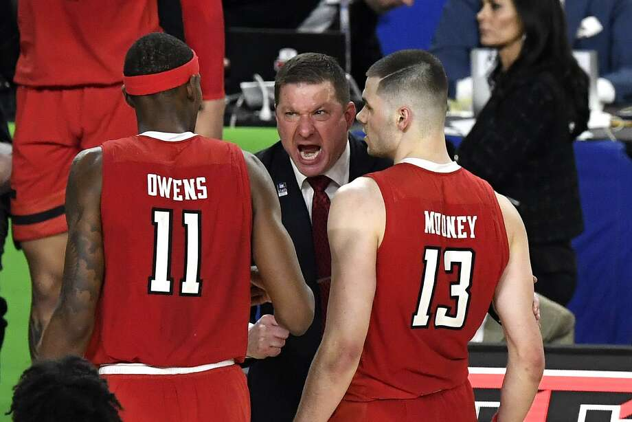 Texas Tech coach Chris Beard, a McCullough High School graduate, reacts with Tariq Owens (11) and Matt Mooney (13) in the first half against the Michigan State Spartans on Saturday. Photo: Hannah Foslien, Stringer / Getty Images / 2019 Getty Images