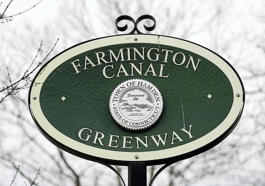 The Farmington Canal Greenway sign, as seen, Thursday, January 12, 2017, on Morse Street in Hamden. The multi-use rail trail started as a waterway, then became a railway and now spans over 80 milesthrough 16 towns from New Haven to Northampton, Massachusetts. (Catherine Avalone/New Haven Register) Photo: Catherine Avalone / Digital First Media / Catherine Avalone/New Haven Register