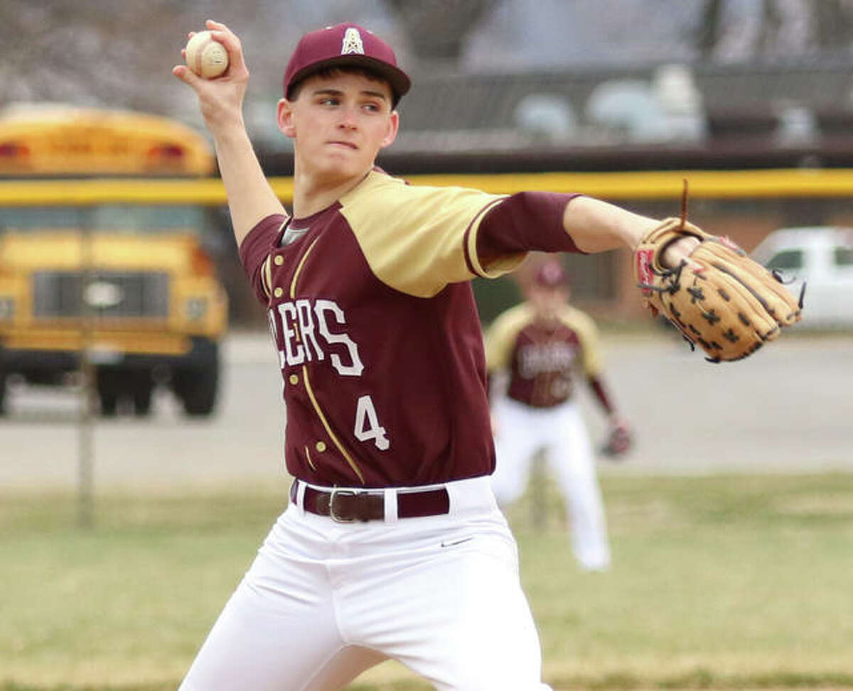 EA-WR's Jake Wells, shown pitching in a game March 20 at Roxana, threw a complete-game to beat Red Bud in the second game of a doubleheader split Saturday in Wood River.