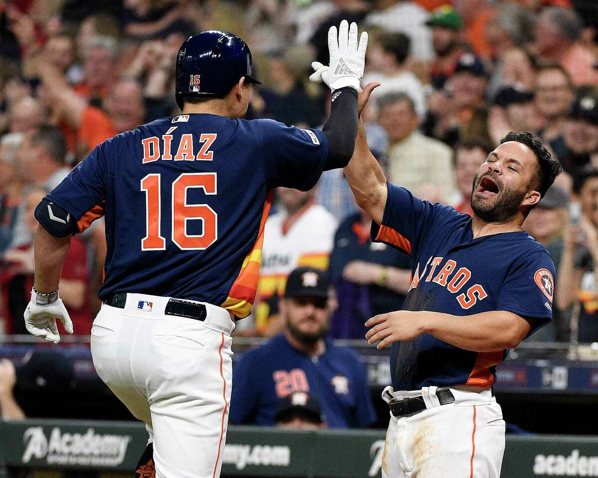 Houston Astros' Aledmys Diaz (16) celebrates his three-run home run off Oakland Athletics starting pitcher Mike Fiers with Jose Altuve during the first inning of a baseball game, Sunday, April 7, 2019, in Houston. (AP Photo/Eric Christian Smith)