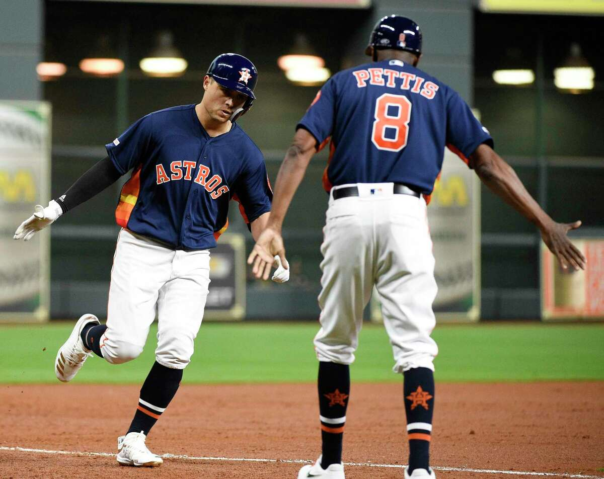 Houston Astros' Aledmys Diaz, left, celebrates his three-run home run off Oakland Athletics starting pitcher Mike Fiers with third base coach Gary Pettis during the first inning of a baseball game, Sunday, April 7, 2019, in Houston. (AP Photo/Eric Christian Smith)